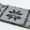 Striped rug with flowers recycled material